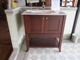 bathroom cozy hexagonal tile flooring with ronbow vanities for