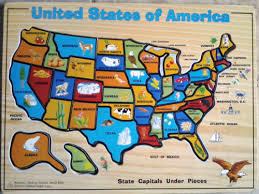 wooden usa map puzzle with states and capitals get a puzzle map of 50 united states see a cow can you guess on