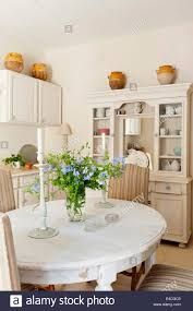 distressed white dining table in provencal style country kitchen