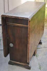 dark wood drop leaf table vintage dark wood gate leg drop leaf dining table with storage