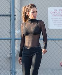 halle berry flashes a lacy black bra in a see through top as she