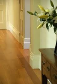 Laminate Flooring Skirting Board Trim by Love The Wall Colour With The White Skirting Board Paint The