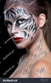 halloween make up woman tiger face stock photo 326589800