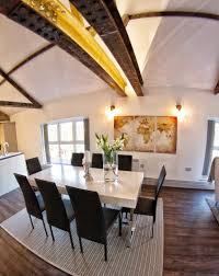peek inside a scandinavian inspired home in swansea nonagon style dining area with gleaming white table black chairs and gray carpet in a scandinavian inspired