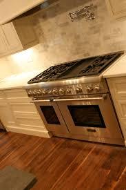kitchen double oven pot filler marble subway tile backsplash