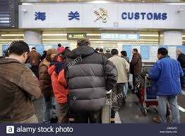 Beijing travelers at the customs check at the airport stock photo