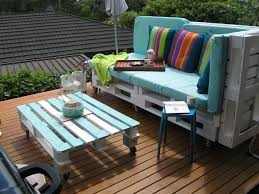 white painted pallet outdoor couch with tall back and light blue