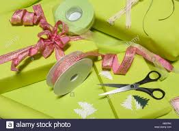 bows for presents table of wrapping paper ribbons and bows to decorate