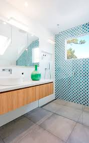 this white and wood bathroom has a bright blue accent wall to