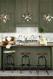 should your kitchen island match your cabinets green kitchen cabinets pleasing design green kitchen island green