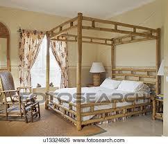 la chambre en espagnol banque d images bambou lit baldaquin et crème chaiselongue