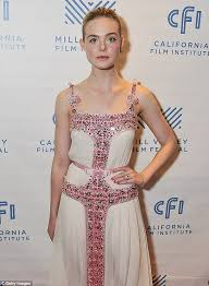 elle fanning looks pretty in pink while attending 20th century
