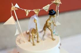 dinosaur wedding cake topper 28 strange wedding cake toppers now that s nifty