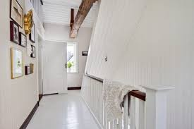 bright alley with white wall decor white wooden floor and big oak