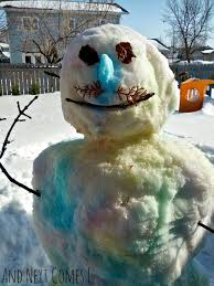 a spray painted snowman and next comes l