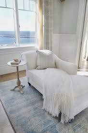 Bedroom Chaise Lounge Chic Bedroom Reading Corner Is Filled With A White Roll Arm Chaise