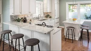 excellent beige kitchen cabinet with white river granite
