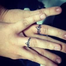 tattoos of wedding rings tattooed wedding rings sweet wedding ring tattoos wrsnh