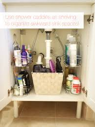 organizing ideas for bathrooms 15 sneaky storage tricks for a tiny bathroom shower caddies