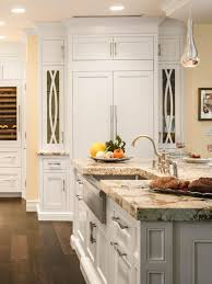 box teak wood stained kitchen islands white marble counter top
