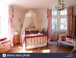 Mosquito Net Curtains by White Voile Mosquito Net Above Brass Bed With Toile De Jouy Cover