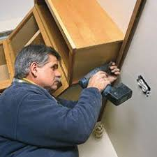 putting up kitchen cabinets how to hang kitchen cabinets hanging kitchen cabinets kitchens