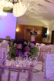wedding flowers surrey pennyhill park wedding flowers crystals bold purple theme