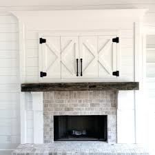 tv stand white entertainment center with tv over fireplace a
