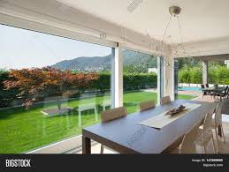 wide open space of luxury house veranda and garden view from the