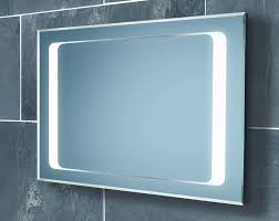 cream wall paint mirror with white wooden frame lamps granite