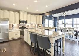buying here model homes offer stone accents flexible floor plans the kitchen in the model at fayette farms features large island seating 1 buying here model homes offer stone accents flexible floor plans