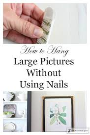 how to hang large pictures without using nails u2013 the crowned goat