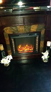 electric fireplace logs near me tv stand menards with mantel and