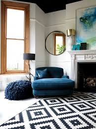big blue comfy chair and patterned rug in living room 47 park
