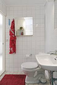 apartment therapy small bathroom renovation gray ceramic laminate