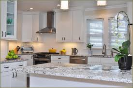 granite countertop white kitchen cabinets grey floor refrigerant