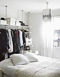 great bedroom with open closet with modern and classical clothes