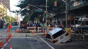 a sinkhole just ate a bmw x5 in new york city the drive