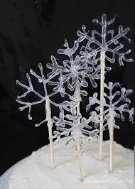 snowflake cake topper make a snowflake cake topper using hot glue diy candy
