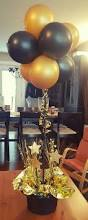 grammy style gold and black centerpiece great for grads and other
