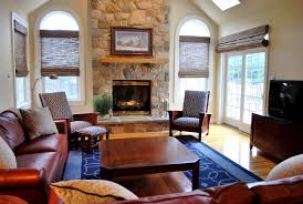 pleasant living room with stone fireplace for your luxury stone
