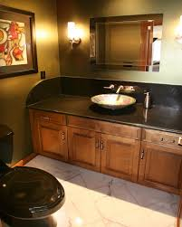amazing bathroom design achieved with black granite countertops amazing bathroom design achieved with black granite countertops large vessel sink and dark wood cabinets