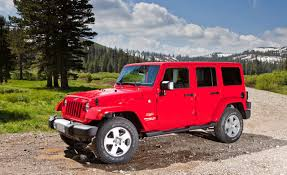 red jeeps view of jeep wrangler unlimited sahara photos video features