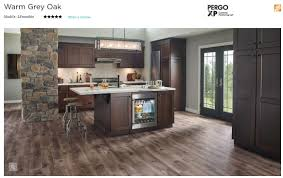 what color wood floor looks with cherry cabinets pergo flooring in warm grey oak it seems to go well with