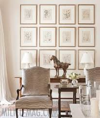 wonderful gallery wall love the thin gold frames very light and
