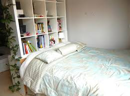 Beds With Bookshelves Diy How To Make Your Own Storage Bed Using A Repurposed Ikea