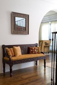 african safari home decor a bench serves as both seating and landing area for mail keys pier