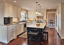 white kitchen cabinets with island the white kitchen cabinets and contrasting