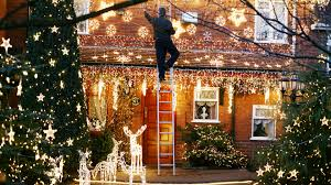 Hanging Christmas Lights by What Doctors Want You To Know About Staying Out Of The Er This