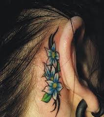 small hawaiian flower tattoo behind ear photos pictures and